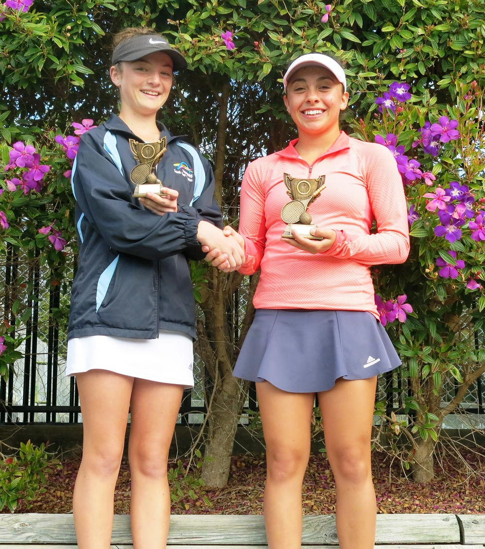 Runner up in the 14 years singles event Natasha Phillips-Edgar congratulates the winner Alyssa Simoncini from Canberra