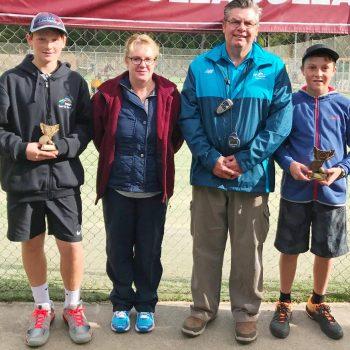 14 years boys singles presentation: Riley White - Runner-up, tournament director Karen Muller, Tennis club president Keith Bonser and the winner Logan Staight from Merimbula